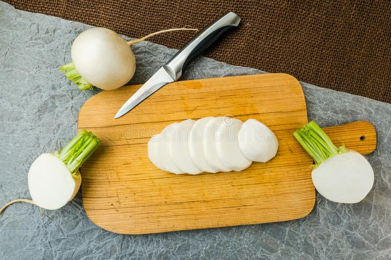 Sliced daikon radish. Tasty fresh crude white round japanese radish royalty free stock images