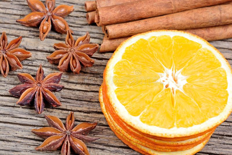 Sliced of dried orange with cinnamon sticks and anise on table stock photography