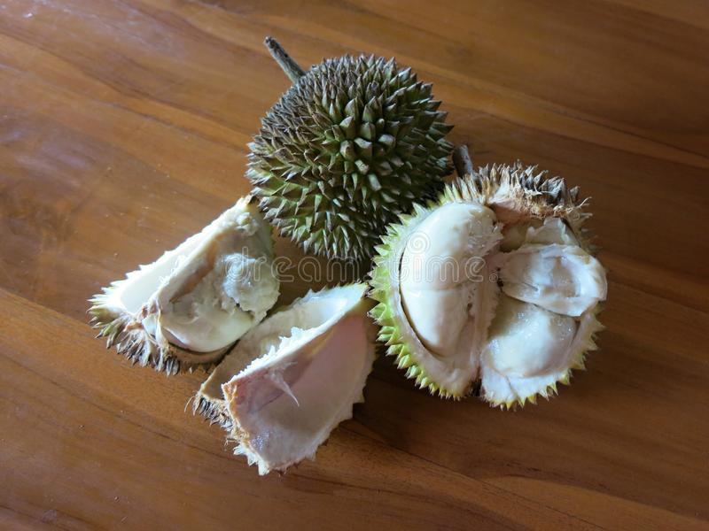 Sliced durian on the table. Hard and sharp spines. Tasty and sweet fruit. stock images