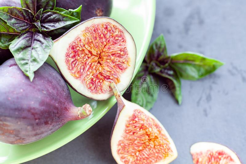 Sliced figs with basil stock photography