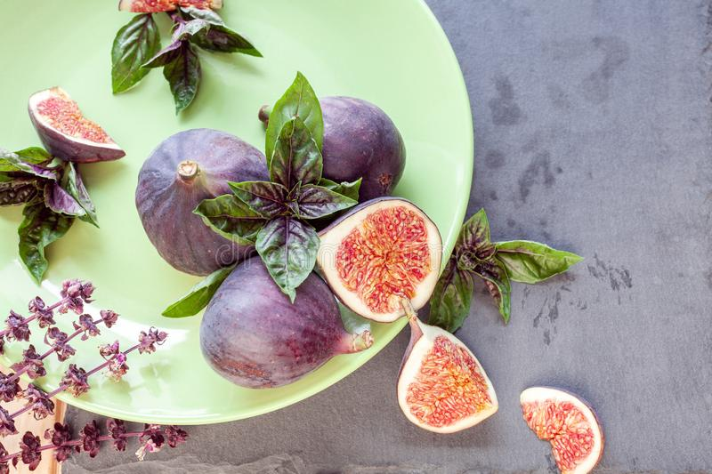 Sliced figs with basil stock image