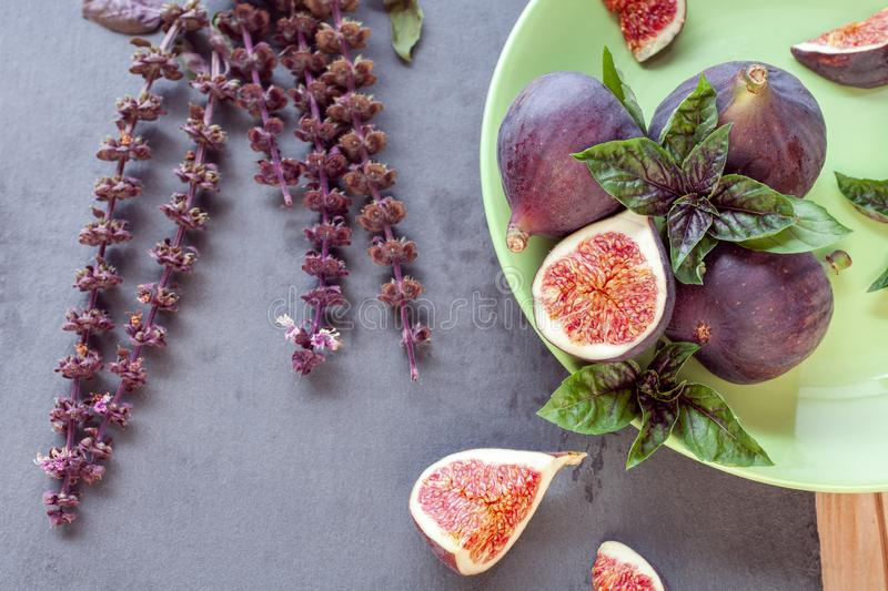 Sliced figs with basil stock photo