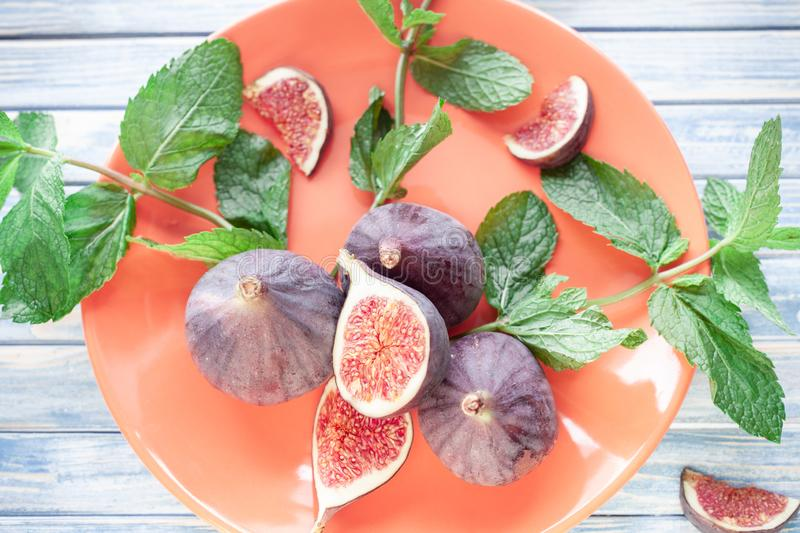 Sliced figs and mint stock image