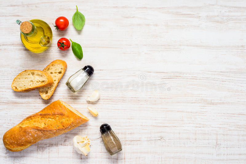 Sliced French Bread with Olive Oil and Copy Space royalty free stock photos