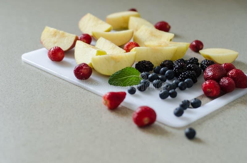 Sliced fresh apples, fresh summer fruits, ingredients for kompot stock image