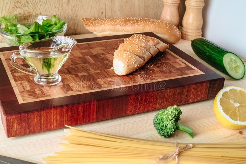 Sliced Fresh Baguette on a Board royalty free stock image