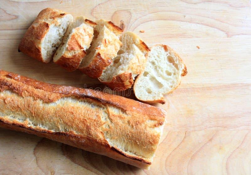 Sliced fresh baguette stock image