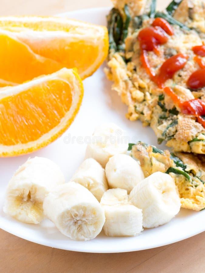 Sliced fresh banana on breakfast plate. Sliced fresh banana on white breakfast plate royalty free stock photography