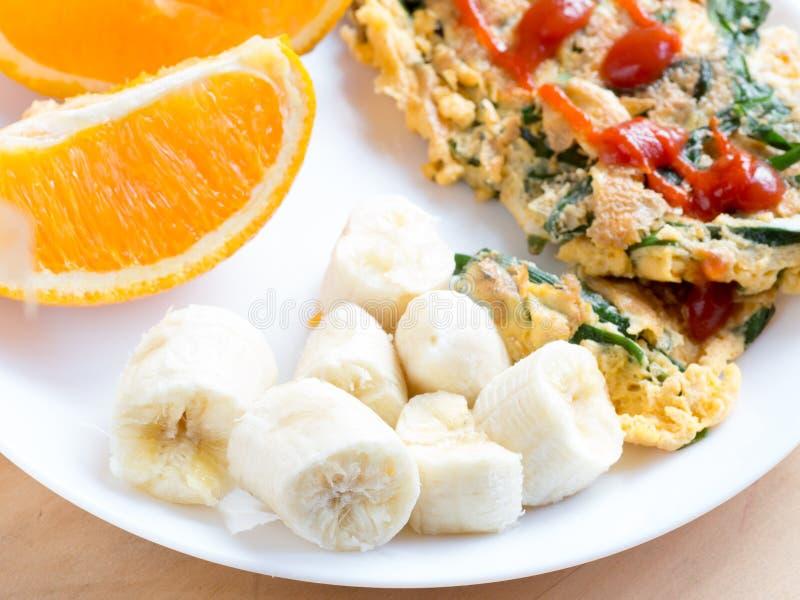 Sliced fresh banana on breakfast plate. Sliced fresh banana on white breakfast plate royalty free stock photos
