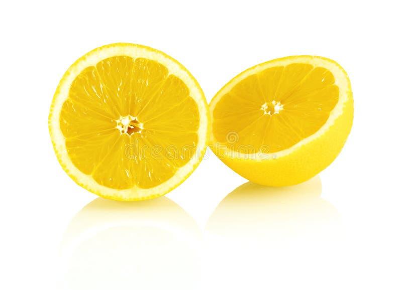 Sliced fresh lemon fruit isolated on white background with shadow reflection. royalty free stock image