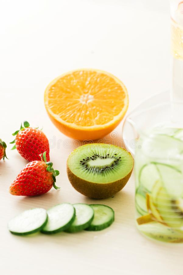 Sliced fresh organic fruits prepared to make infused water royalty free stock image