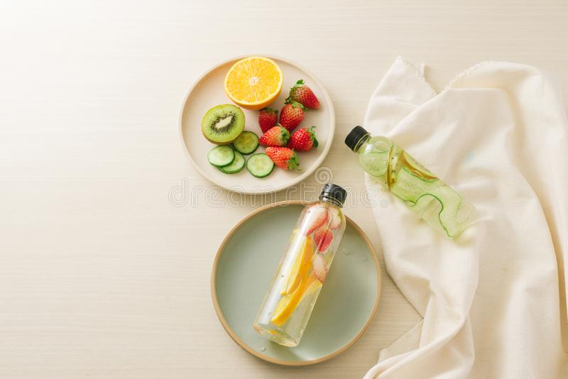 Sliced fresh organic fruits prepared to make infused water royalty free stock images