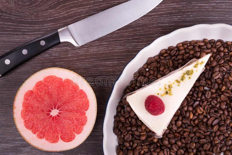 Sliced fruit and a desert on a wooden background stock image
