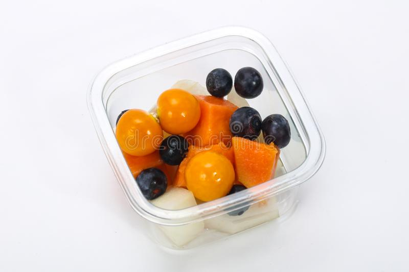 Sliced fruit mix in the box stock photos