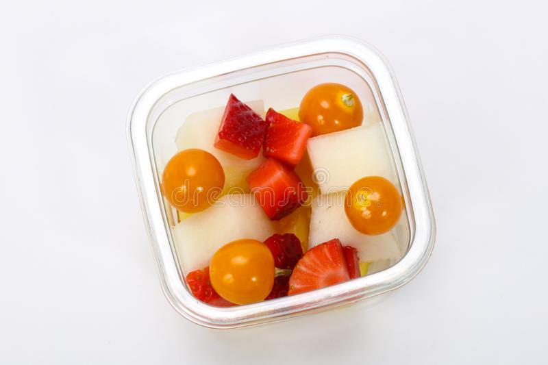 Sliced fruit mix in the box royalty free stock photo