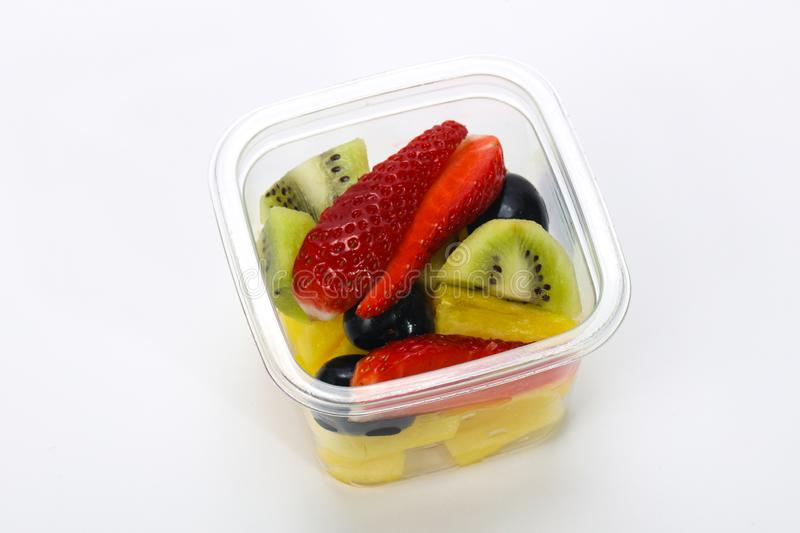 Sliced fruit mix in the box royalty free stock image