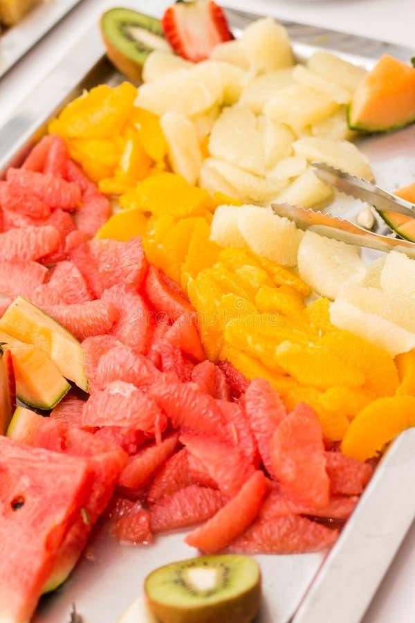 Sliced fruit platter on stainless steel tray. Fruit platter on stainless steel tray royalty free stock image