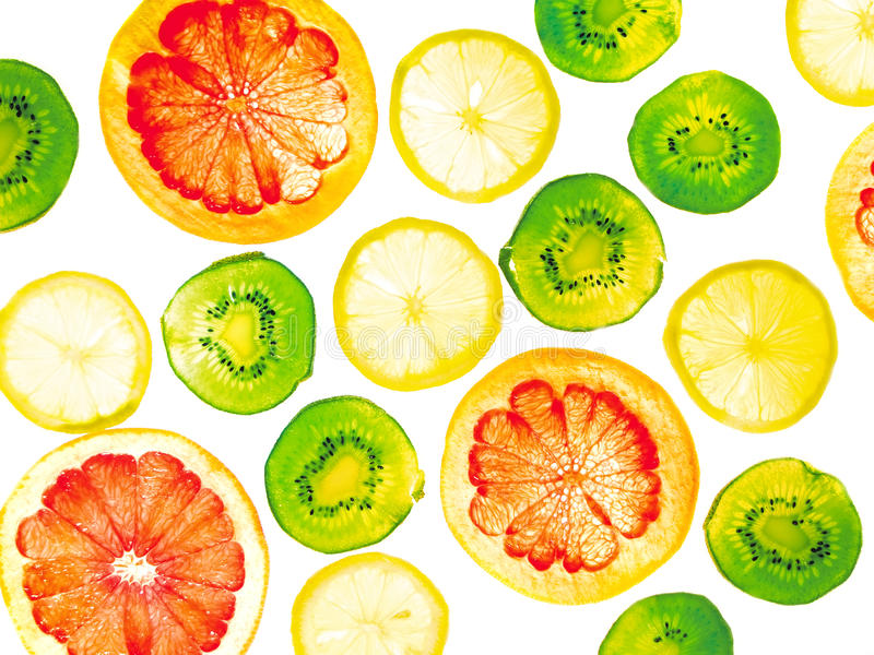 Sliced fruits background. Citrus close-up royalty free stock photography