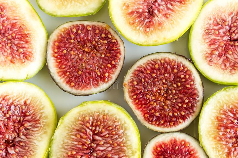 Sliced fruits background. Slices of juicy red figs. Beautiful natural background stock image