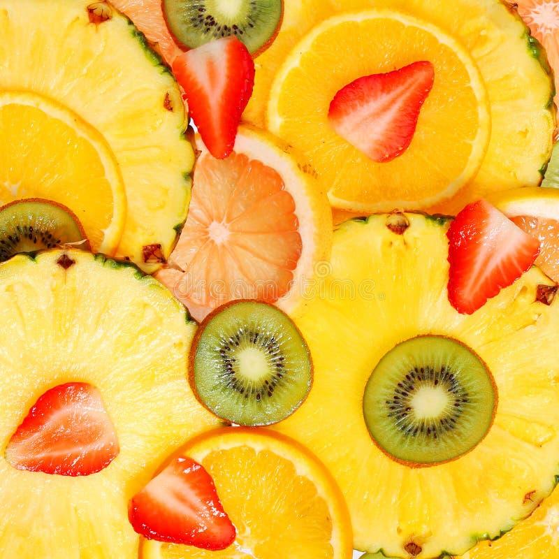 Sliced Fruits. Background. Strawberry, Kiwi, Pineapple. Grapefruit and Orange stock photo