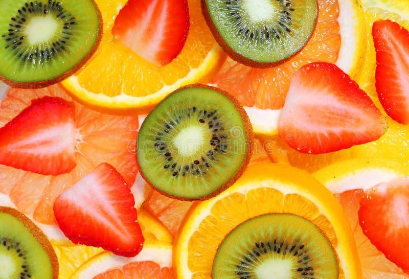 Sliced Fruits. Background. Strawberry, Kiwi, Pineapple Grapefruit and Orange stock photos