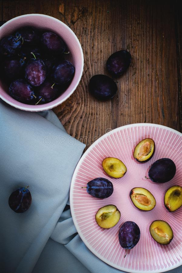Sliced Fruits on Pink Ceramic Plate royalty free stock image