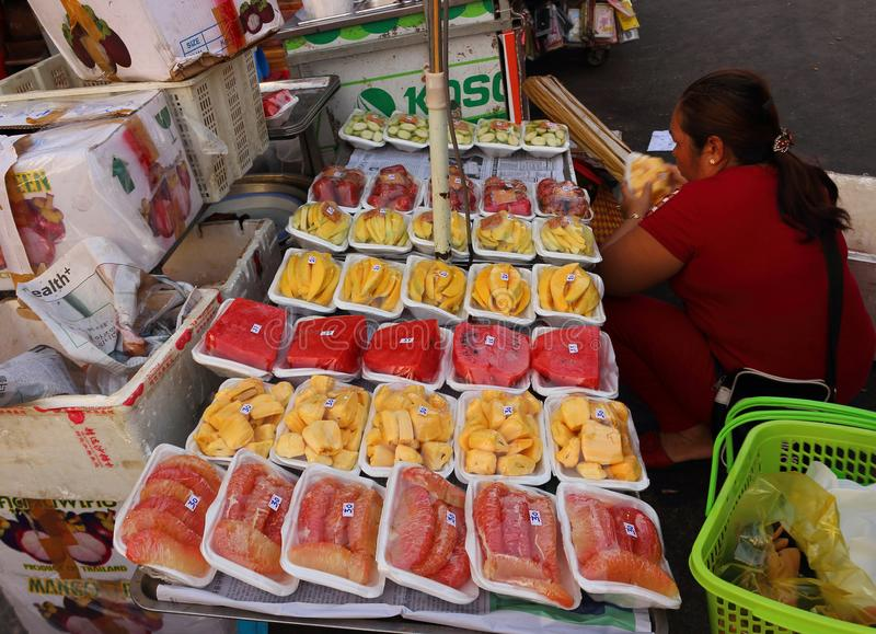 Sliced fruits for tourists in street market royalty free stock image