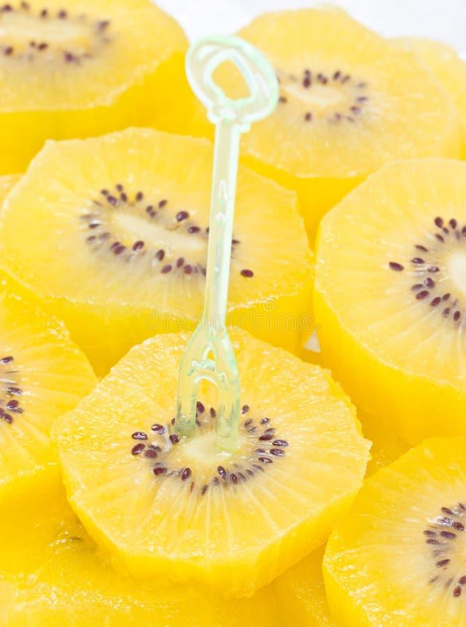Download Sliced Golden Kiwi Fruit With Plastic Fork. Stock Image - Image: 34260989