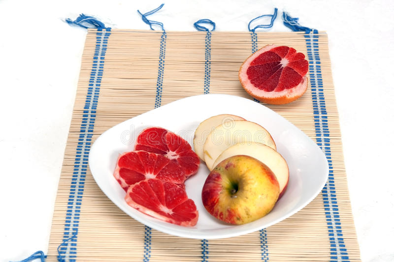 Sliced Grapefruit And Apple Stock Images