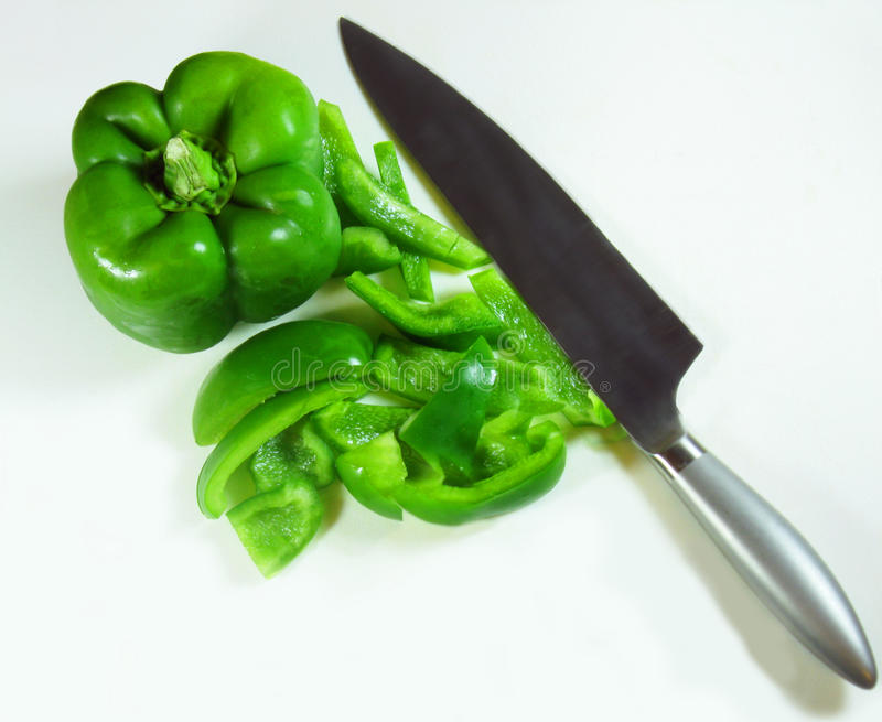 Sliced Green Bell Pepper with Knife stock photography