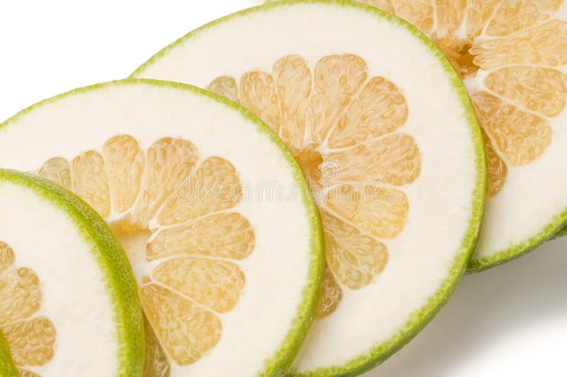 Sliced Green Grapefruit Jaffa Sweetie, isolated on white backg. Set of fresh whole and cut Green Grapefruit Jaffa Sweetie and slices isolated on white background royalty free stock photography