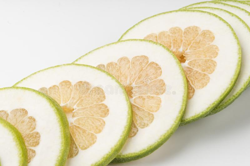 Sliced Green Grapefruit Jaffa Sweetie, isolated on white backg. Set of fresh whole and cut Green Grapefruit Jaffa Sweetie and slices isolated on white background stock photos