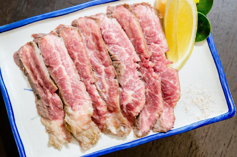 Sliced grilled Strip Loin rare degree of ripeness beef steak stock images