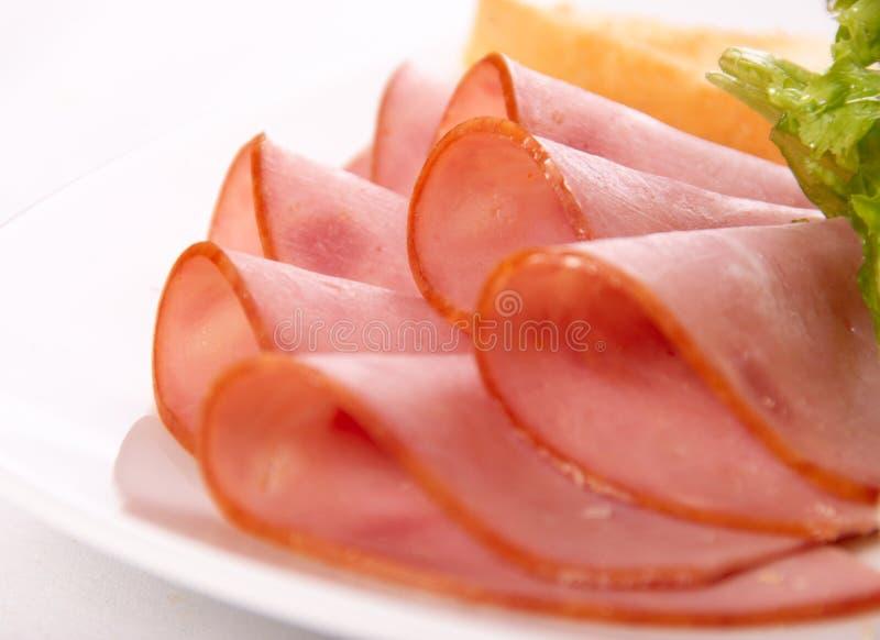 Sliced ham. On the plate macro shot stock photo