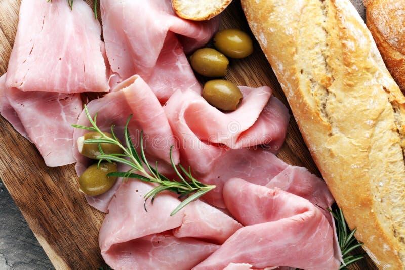 Sliced ham on wooden board. Fresh prosciutto. Pork ham sliced. stock photography