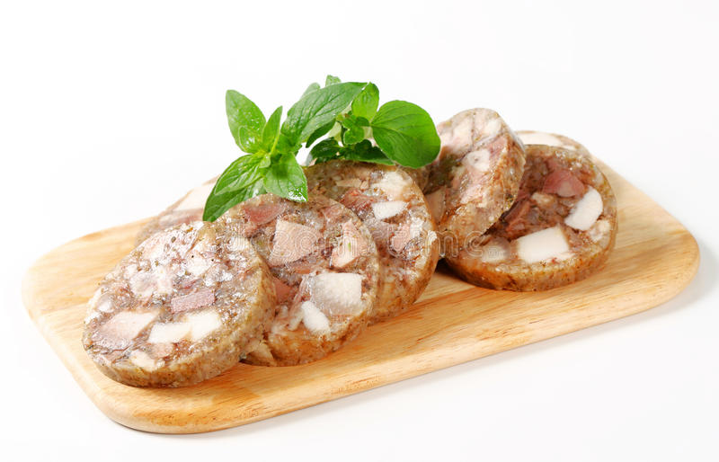 Sliced head cheese. On a cutting board royalty free stock photography