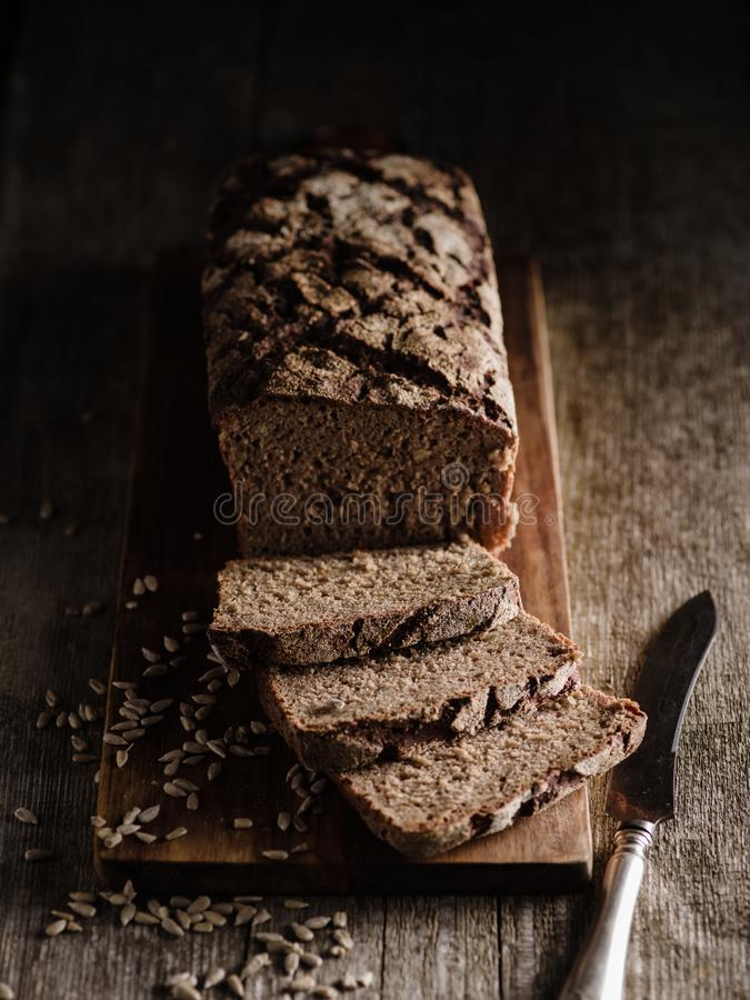 Sliced Homemade rye bread. Rustic style royalty free stock images