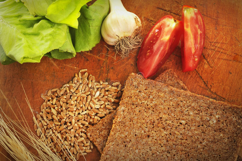 Sliced integral bread and vegetables royalty free stock photos