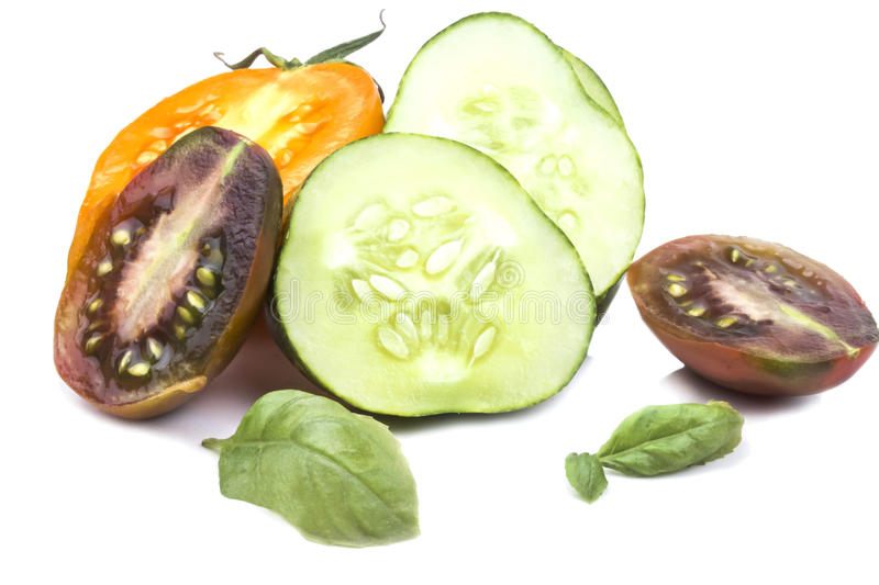 Sliced juicy ripe cucumber and tomato slices royalty free stock photos