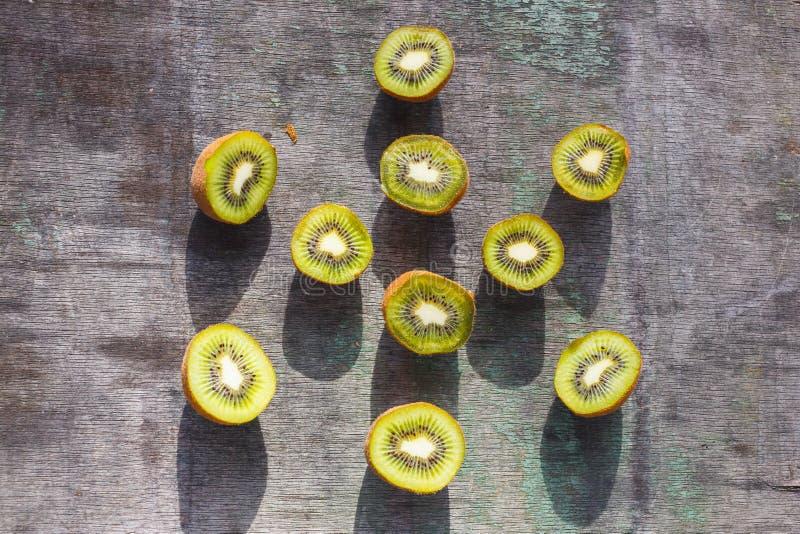 Sliced Kiwi Fruit on a gray vintage table.  stock image