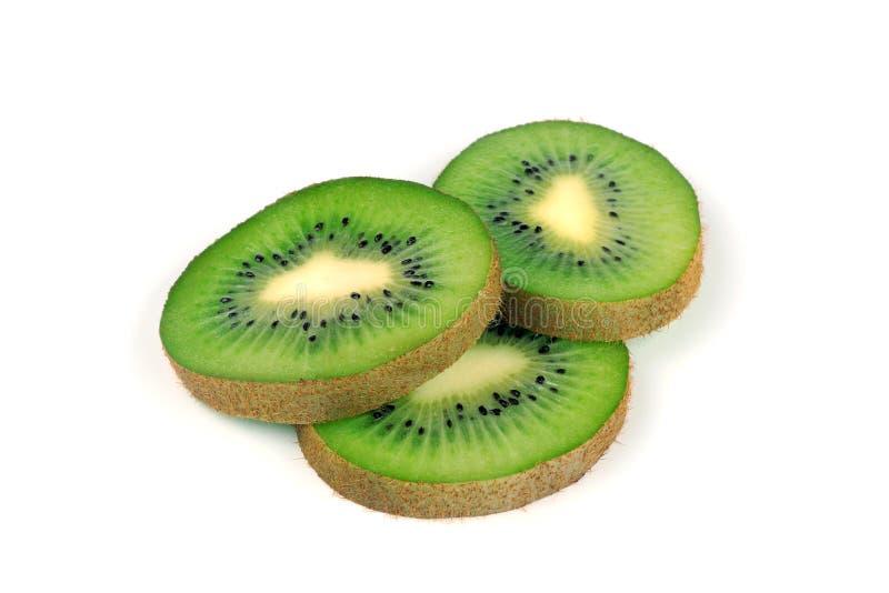 Sliced kiwi fruit isolated on white background. Isolated on white royalty free stock images