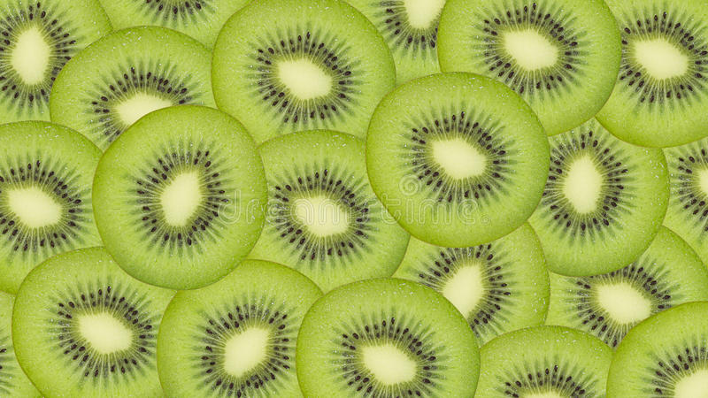 Sliced kiwi fruit pattern background stock photography