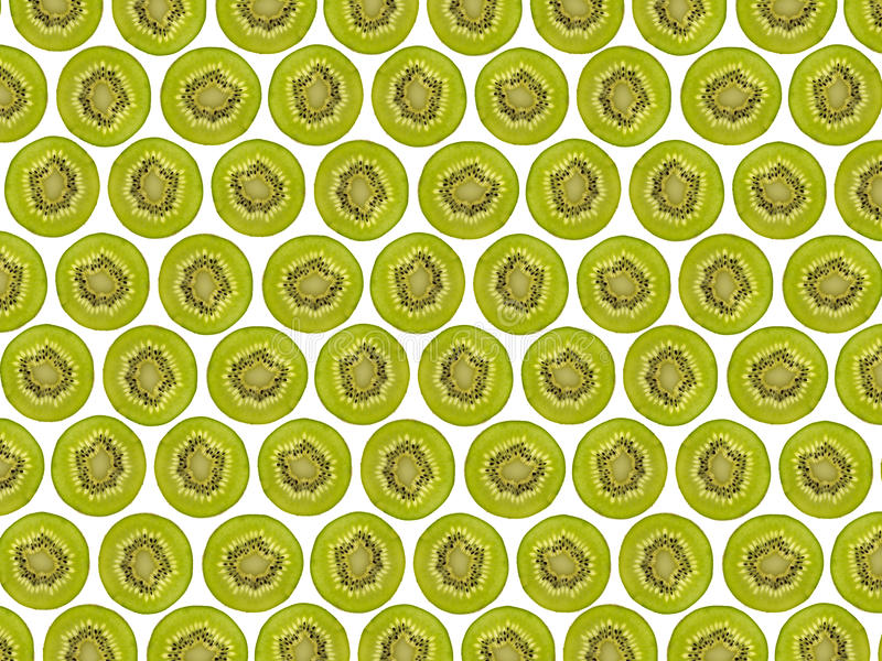 Sliced kiwi fruit pattern, halved kiwis royalty free stock photography