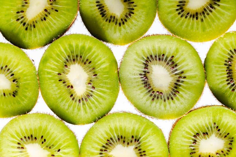 Sliced Kiwi fruit on white background stock photography