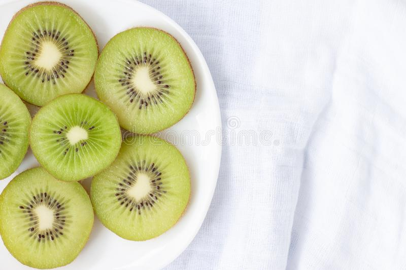 Sliced kiwi fruit in white plate. royalty free stock photography
