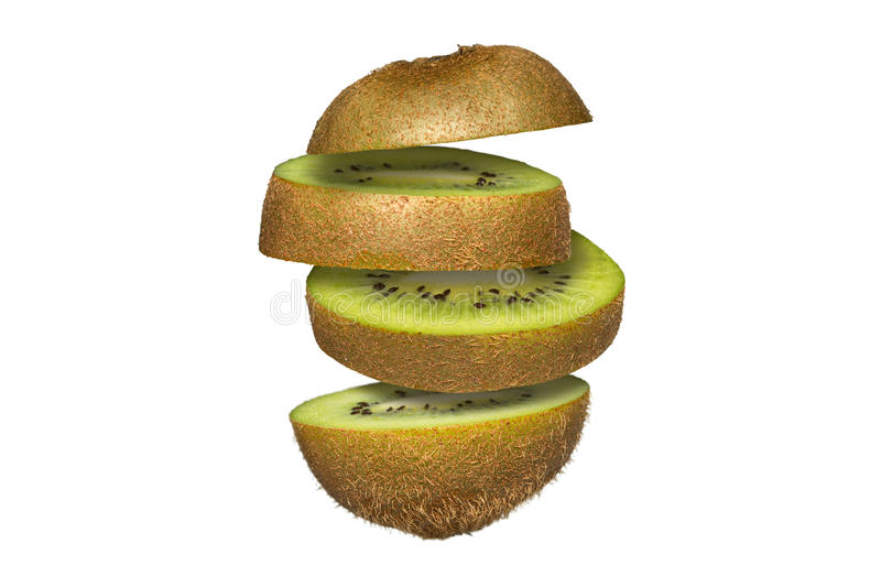 Sliced kiwi isolated on white background. Flying fruit floating in the air. royalty free stock photography