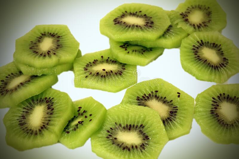 Sliced kiwis on a white background. So good delicious yum stock images