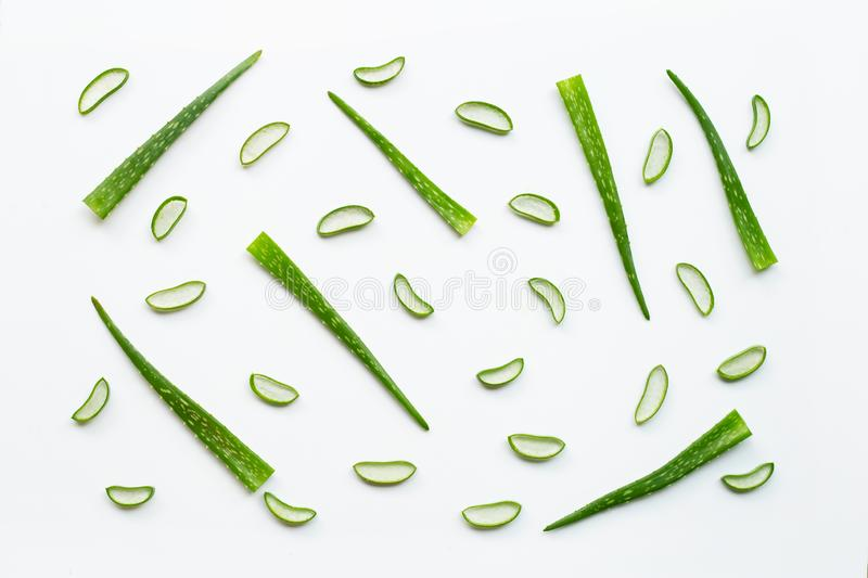 Sliced and leaves of fresh aloe vera on white background. Top view stock photography
