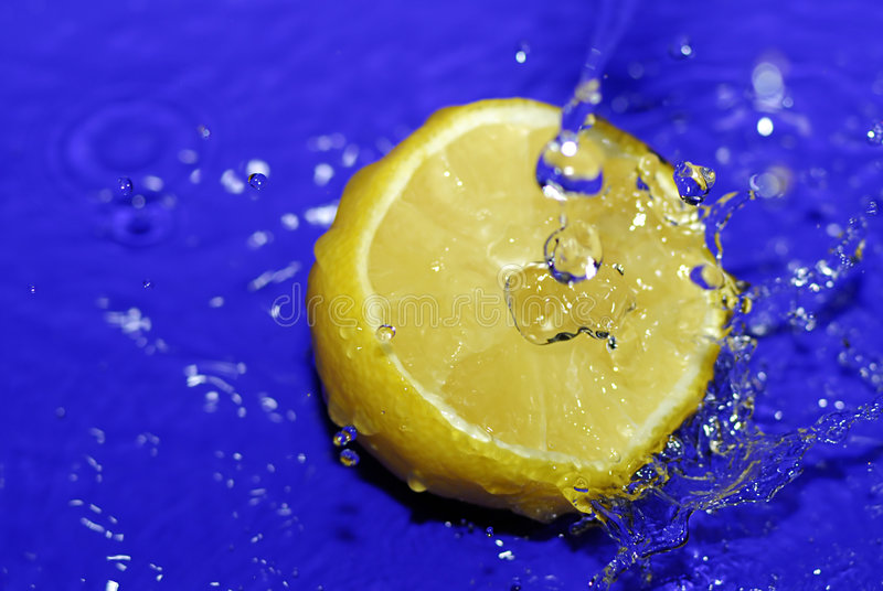 Download Sliced lemon in blue water stock photo. Image of sliced - 1725846
