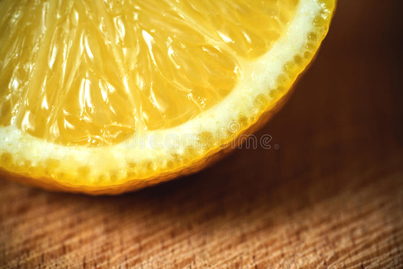 Sliced lemon on a cutting board .wooden background stock images